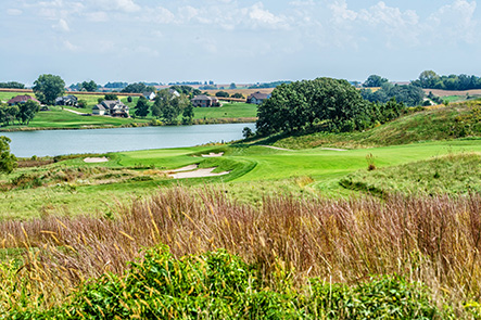 Hole 16 preview shows natural greenery in the foreground and a body of water in the background with the hole wedged between.