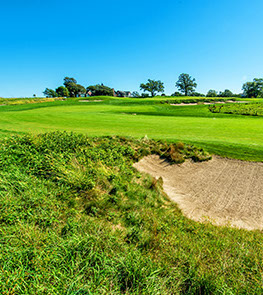 Hole 2 preview displays beautiful greens under a bright blue Iowan sky surrounded by natural landscaping and sand traps.