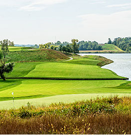 Hole 9 preview shows the green lined by a large body of water on one side, split by a canal.